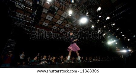 Female model at a fashion show on the catwalk (Russian Fashion Week) 08 - stock photo