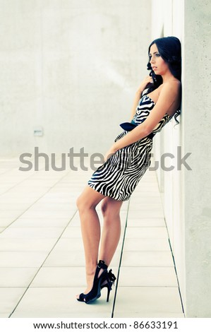 Female model at fashion in the street - stock photo