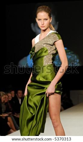 Female model at fashion show - stock photo