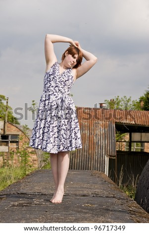 Female Model in an Abondoned Prisoner of War Camp - stock photo