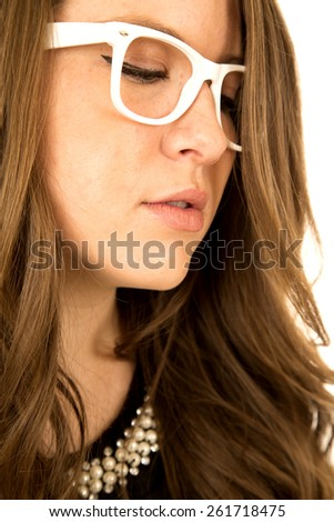 female model looking down wearing white glasses