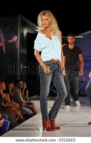 Female model on catwalk - stock photo