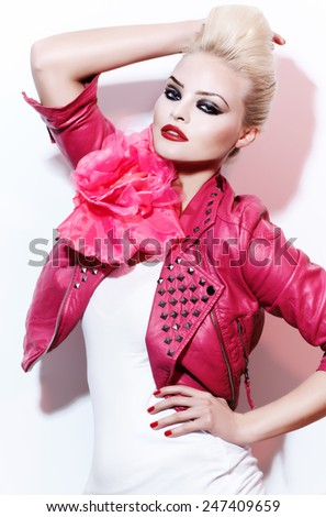 Female model wearing leather jacket with a huge pink rose.