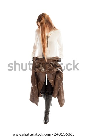 Female model with beautiful  long hair wearing brown leather jacket on her waist - stock photo