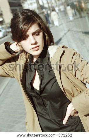 female model with hand behind head - stock photo
