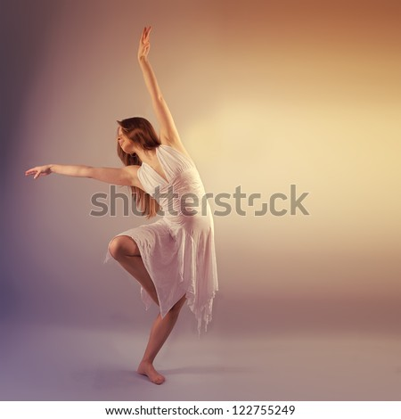 Female Modern Style Dancer Posing In Studio