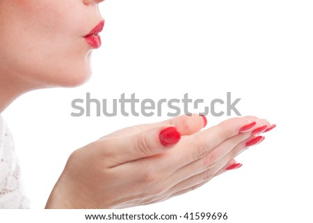 Female mouth blowing a kiss on white background - stock photo