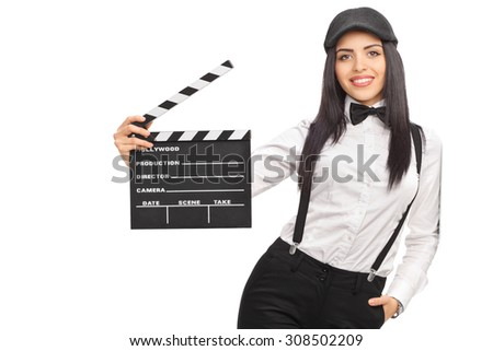 Female movie director in an artistic outfit and holding a clapperboard isolated on white background - stock photo