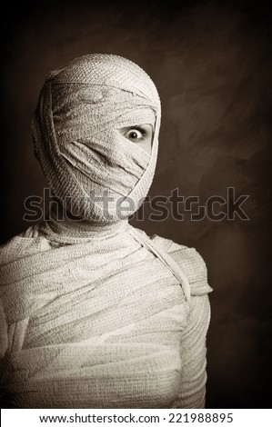 female mummy in grungy sepia vintage horror halloween style - stock photo