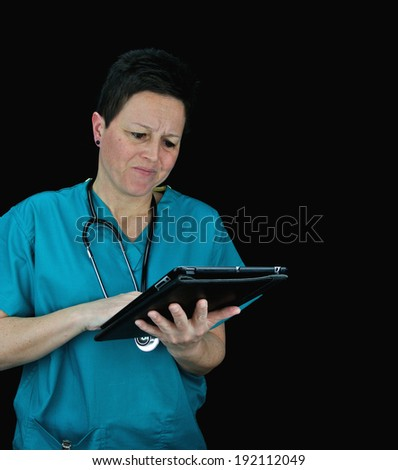 Female nurse/doctor/vet/health care worker using tablet, confused. Portrait against black background. - stock photo
