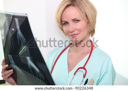 Female nurse holding x-ray image