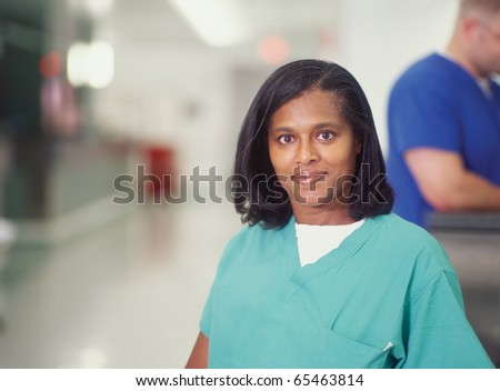 Female nurse in hospital hallway - stock photo