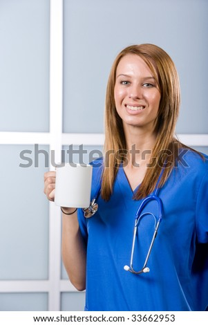 Female Nurse portrait in a modern Hospital - stock photo