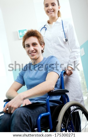 Female nurse pushing her patient on a wheelchair