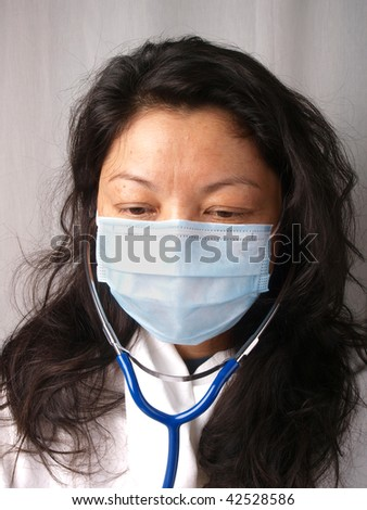 Female nurse wearing face mask. Close up