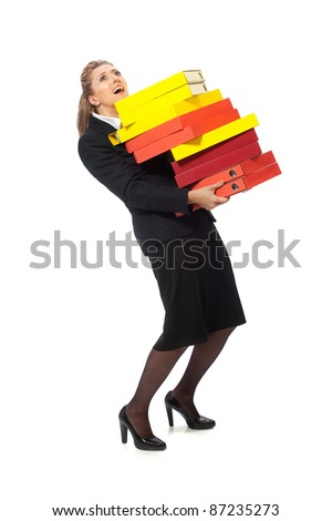 Female office worker carrying heavy stack of files on a white background - stock photo