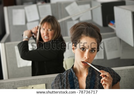 Female office worker thinks while her colleague threatens to stab her with a Samurai sword - stock photo