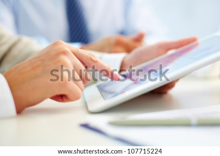 Female office worker using touchpad