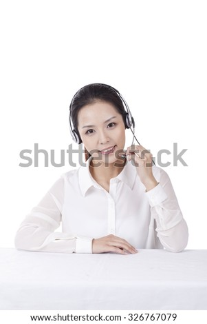 Female office worker wearing headset,portrait
