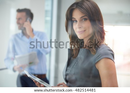Female office worker with digital tablet