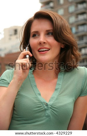 Female on her mobile phone in the city