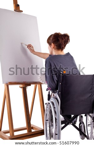female on wheelchair painting picture isolatedo on white background - stock photo