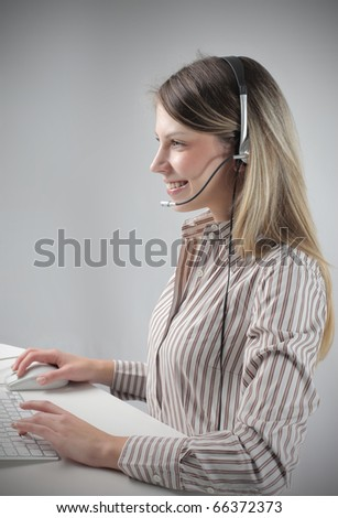 female operator sitting in front of a computer - stock photo