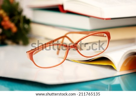 female orange glasses books and journal background