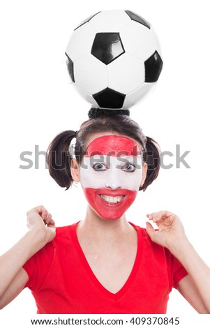 female, painted austria soccer fan with ball is looking happy, isolated on white