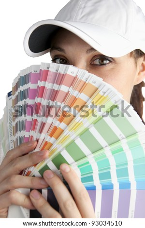 female painter hiding her face up to eyes with color chart - stock photo