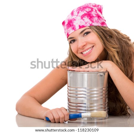 Female painter with a paint can and a brush - isolated over a white background - stock photo