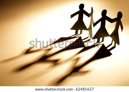 Female paper-chain holding hands - stock photo