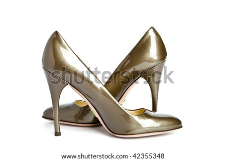 Female patent-leather shoes high-heeled, focus on back shoe - stock photo