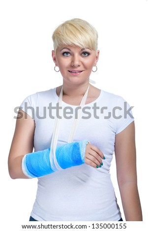 Female patient with broken arm in cast on a white background - stock photo