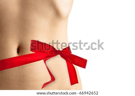 Female perfect waistline wrapped with a beautiful red ribbon like a present