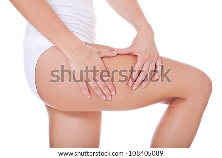 Female person checks her skin on cellulite. All on white background. - stock photo