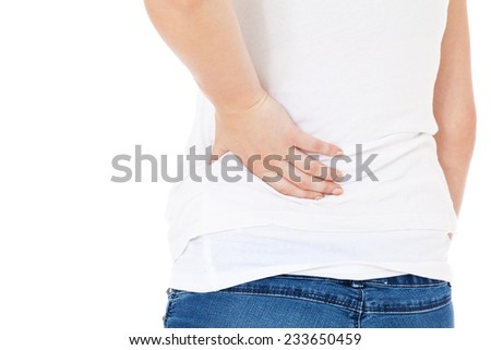 Female person suffers from back pain. All on white background. - stock photo