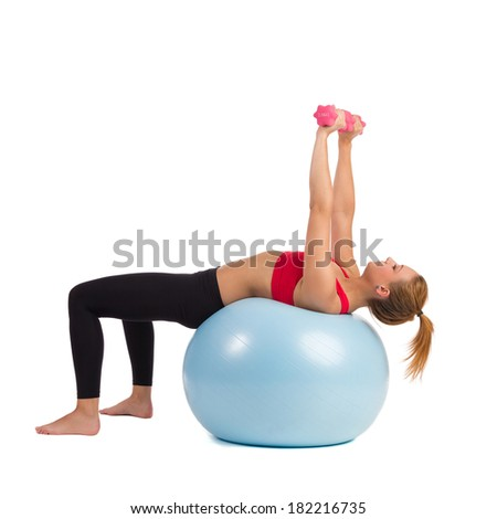 Female Personal Trainer in a correct workout pose for exercise ball hand weights lifts. Full length studio shot isolated on white. - stock photo