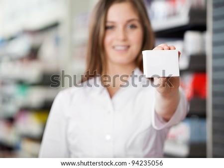 Female pharmacist advising to prefer prescribed medicine - stock photo
