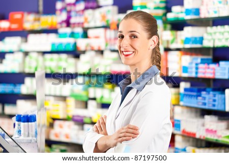 Female pharmacist is standing in her drugstore behind the counter
