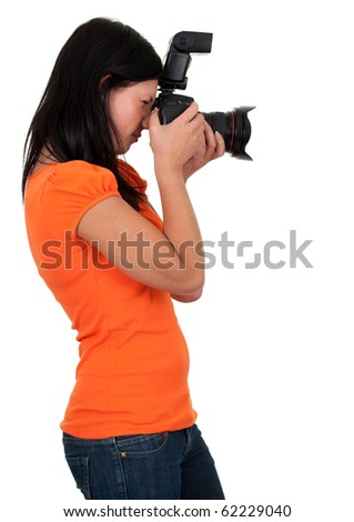 female photographer in orange blouse with professional digital camera