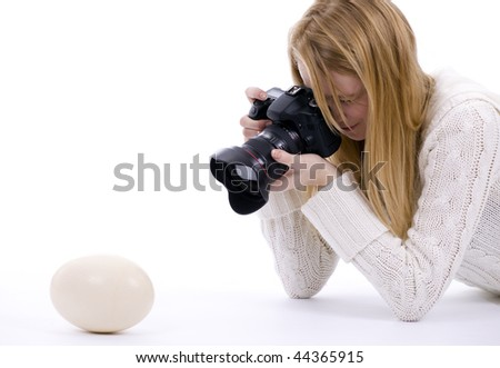 Female Photographer Shooting Ostriches Egg by Professional Digital Camera
