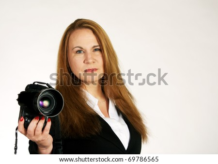 Female photographer with modern digital SLR camera. - stock photo