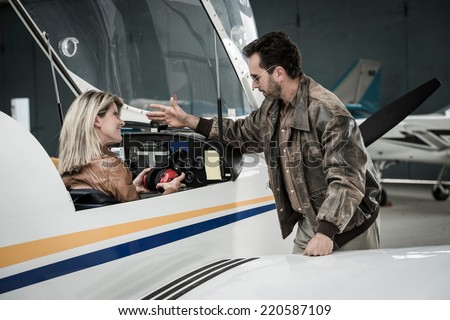 Female pilot with instructor - stock photo
