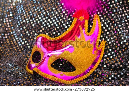 Female pink carnival mask - stock photo
