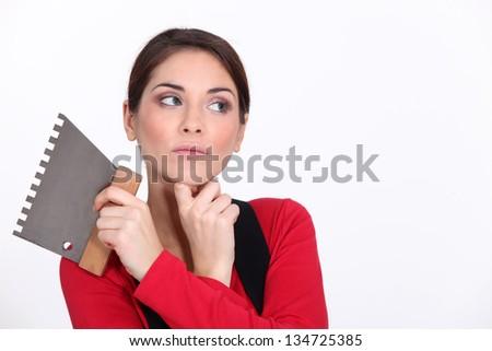 Female plasterer thinking - stock photo