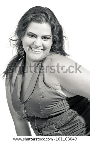 Female Plus size model posing in the studio, fashion portrait, on white background. The woman is smiling in a happy manner. Good for concept of health, happiness, dieting, obesity, weight loss. - stock photo