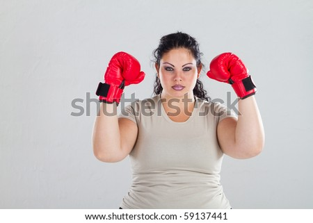 female plus size woman with boxing gloves - stock photo