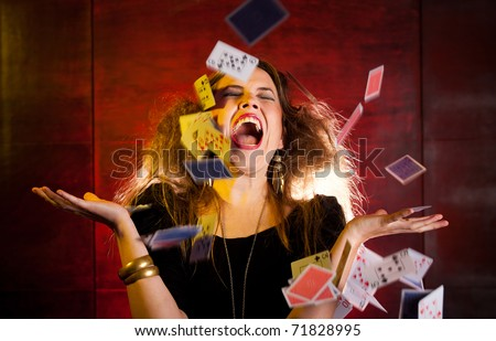 Female poker player throwing the cards in the air