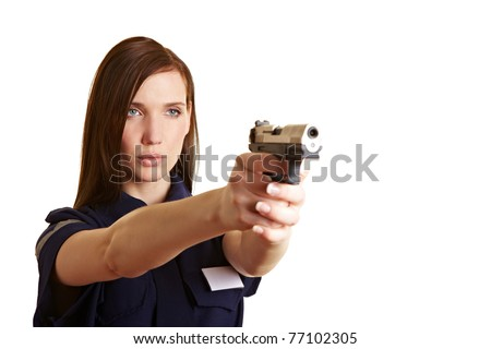 Female policer officer aiming her service weapon - stock photo